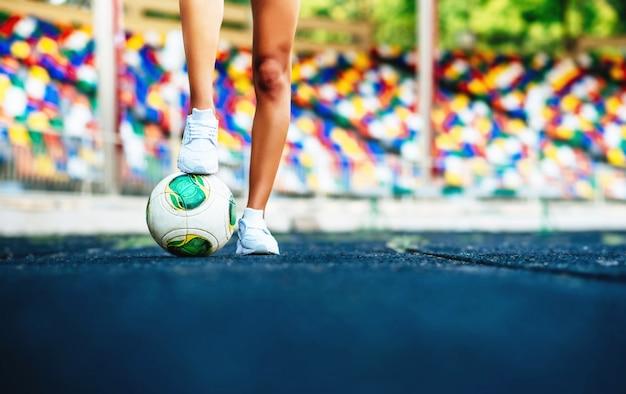 Girl with ball workout on the stadium Premium Photo