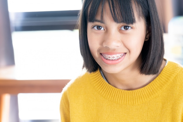 Girl with braces teeth smiling and happy Premium Photo