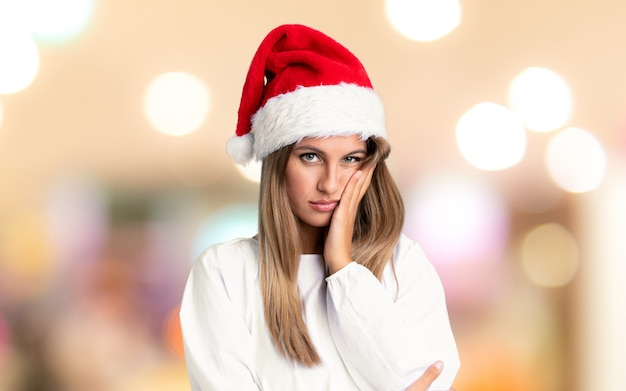 Girl with christmas hat unhappy and frustrated over unfocused wall Premium Photo