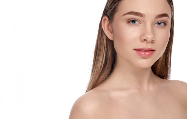 Girl with clear skin posing on white isolated background Premium Photo