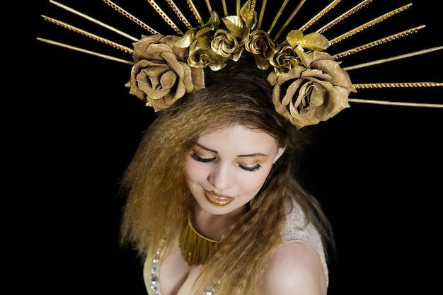 Girl with a crown on his head and golden apple Premium Photo