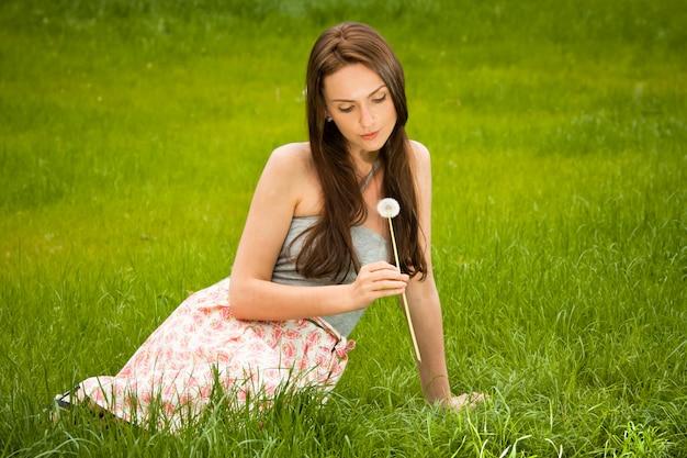 Girl with dandelion Premium Photo