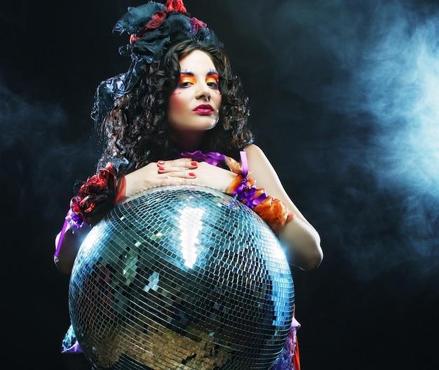 Girl with disco ball Premium Photo
