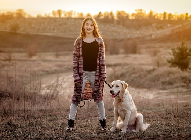 Girl with dog in nature Premium Photo