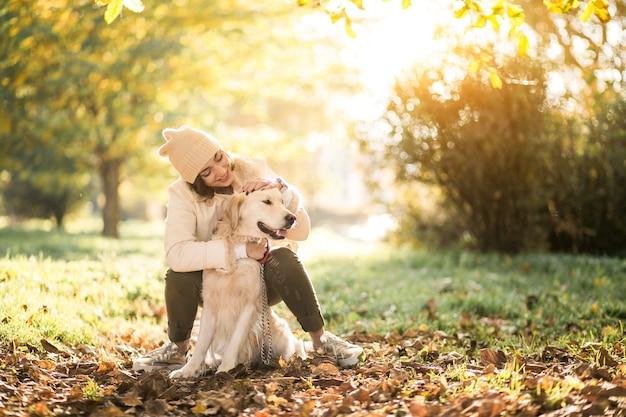 Girl with dog Free Photo