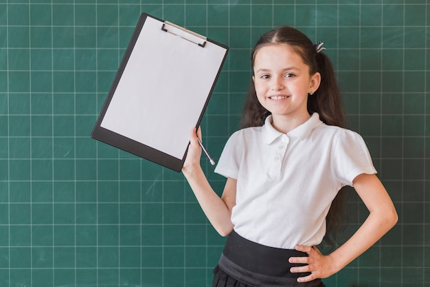 Girl with file holder near blackboard Free Photo