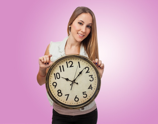 Girl with a giant clock Free Photo