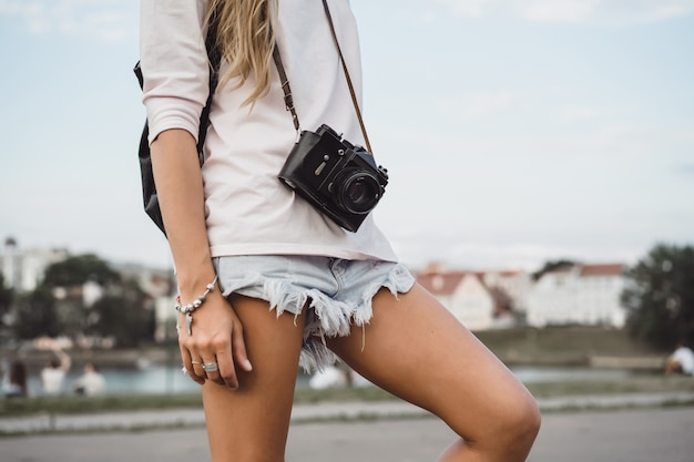 Girl with long hair with skateboard photographing on camera. street, active sports Free Photo