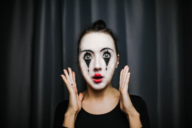 The girl with makeup of the mime. improvisation. Premium Photo