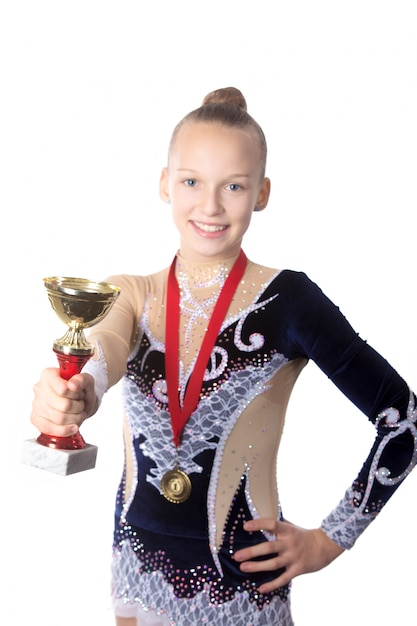 Girl with a medal and a trophy Free Photo