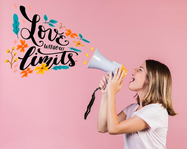 Girl with megaphone and quote for valentines day Premium Photo