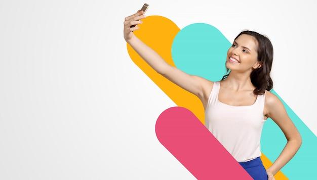 Girl with mobile phone Premium Photo