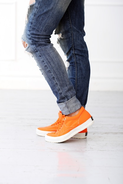 Girl with orange shoes Free Photo