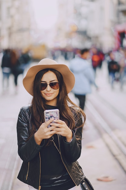 Girl with phone in istanbul Free Photo