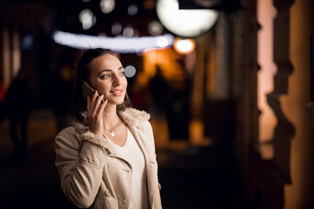 Girl with phone at night Free Photo