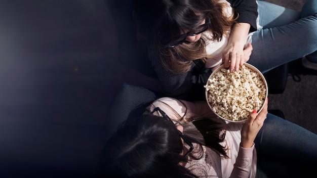 Girl with popcorn in cinema Free Photo