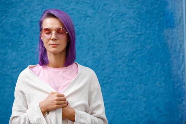 Girl with purple hair on blue Premium Photo