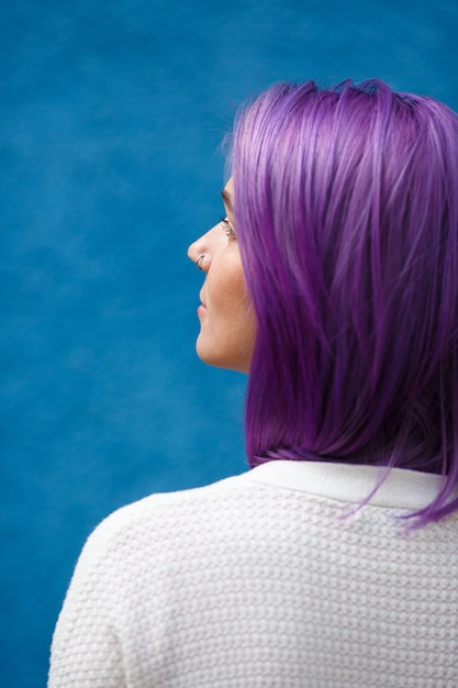 Girl with purple hair on blue Premium Photo