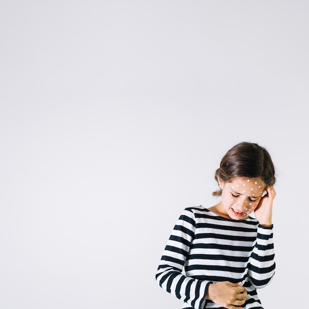 Girl with rash suffering from pain Free Photo