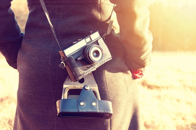 Girl with retro vintage camera. Free Photo