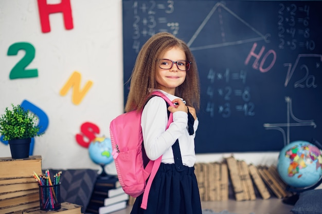 Girl with a school backpack Premium Photo