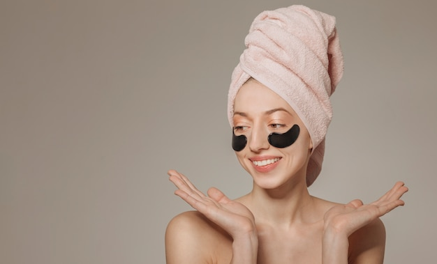Girl with towel on the head with face mask Free Photo