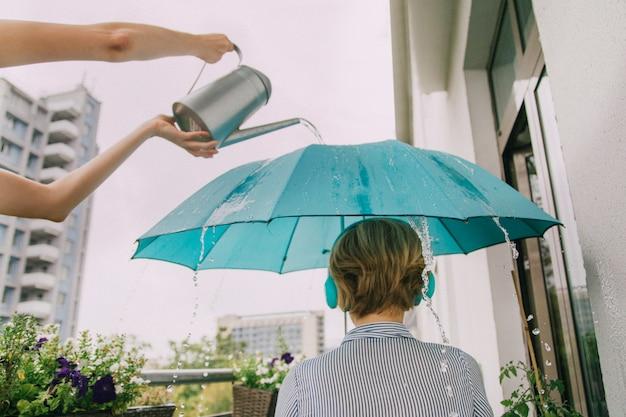 Girl with turquoise umbrella in headphones. Premium Photo