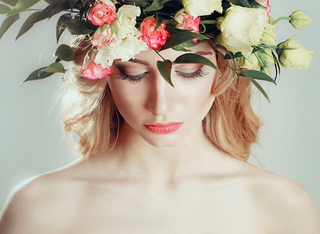 Girl with a wreath of flowers on her head Premium Photo