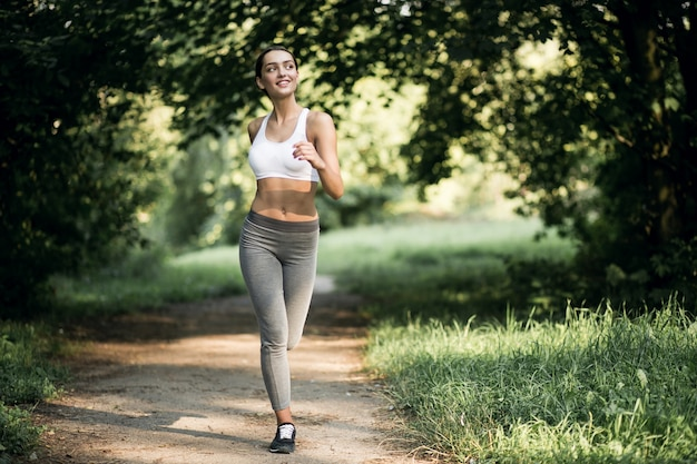 Girl woman earphones run women sports Photo | Free Download
