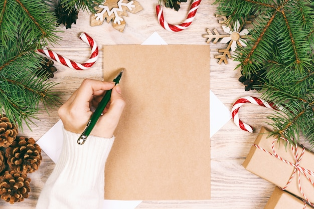 Girl writing a christmas letter background Premium Photo