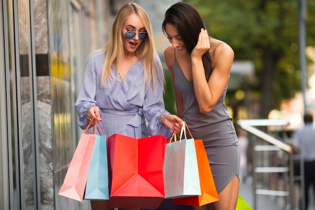 Girlfriends showing each other what they bought Free Photo