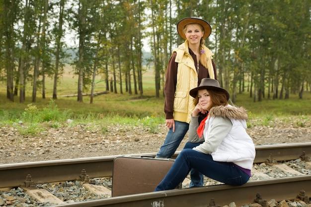 Girls along  railroad rail Free Photo