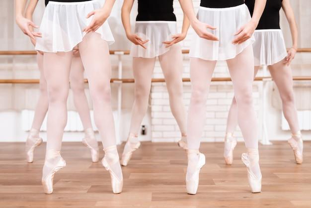 Girls ballet dancers rehearse in ballet class in pointe. Premium Photo