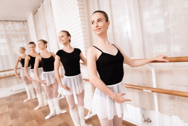Girls ballet dancers rehearse in ballet class. Premium Photo