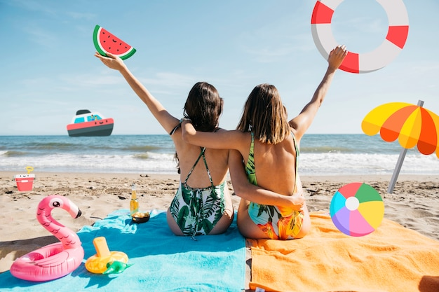 Girls at the beach with icon objects filter Free Photo