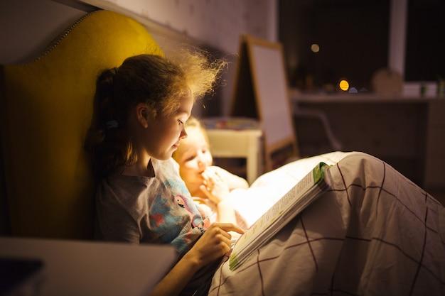 Girls best friends read fairy tale before sleep  best books