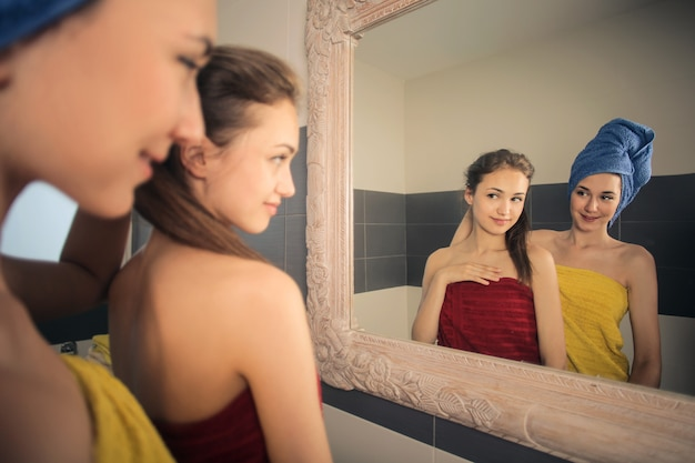 Girls checking theirselves in the mirror Premium Photo