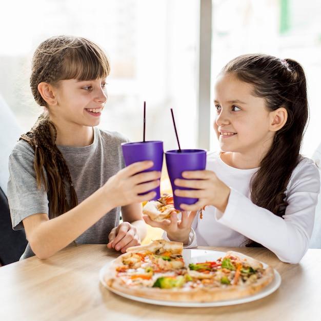 Girls eating pizza Free Photo