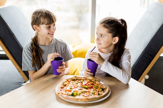 Girls eating pizza Free Photo