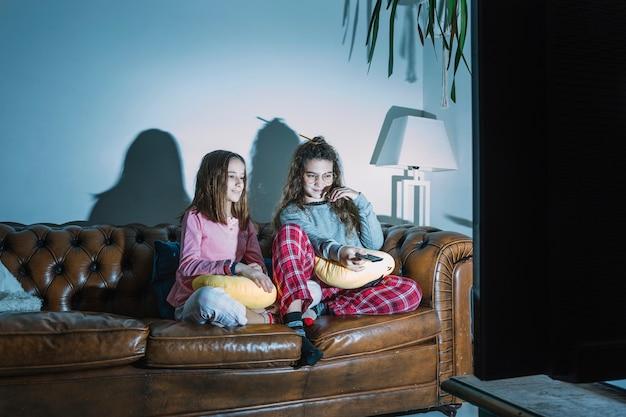 Girls enjoying tv show Free Photo