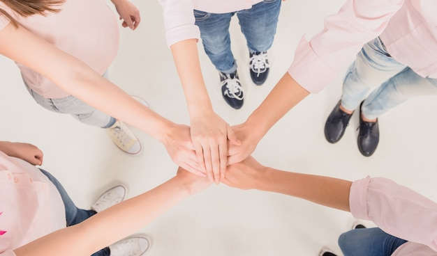 Girls hold hands together and stand in a circle. Premium Photo