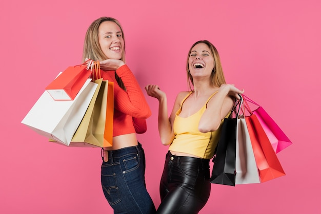 Girls holding shopping bags Free Photo