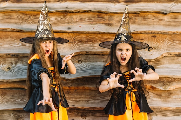 girls in halloween costumes pretending wicked spell free photo