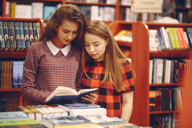 Girls in a library Free Photo