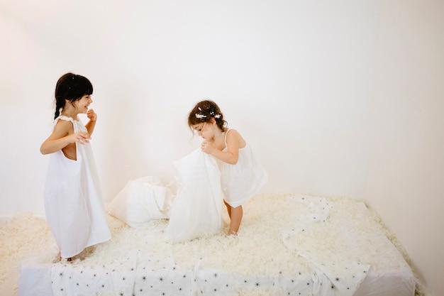 Girls playing on mattress Free Photo