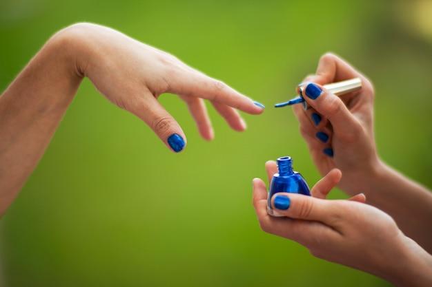 Girls polishing their nails Free Photo