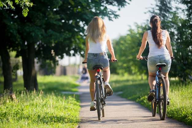 Girls riding a bike from behind Free Photo