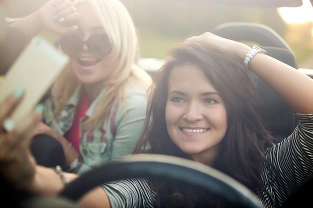 Girls smiling in a car Premium Photo