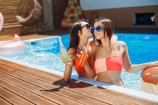 Girls on summer party in the swimming pool Free Photo