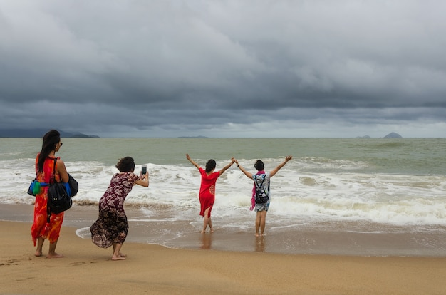 Girls taking selfie on the beach Premium Photo